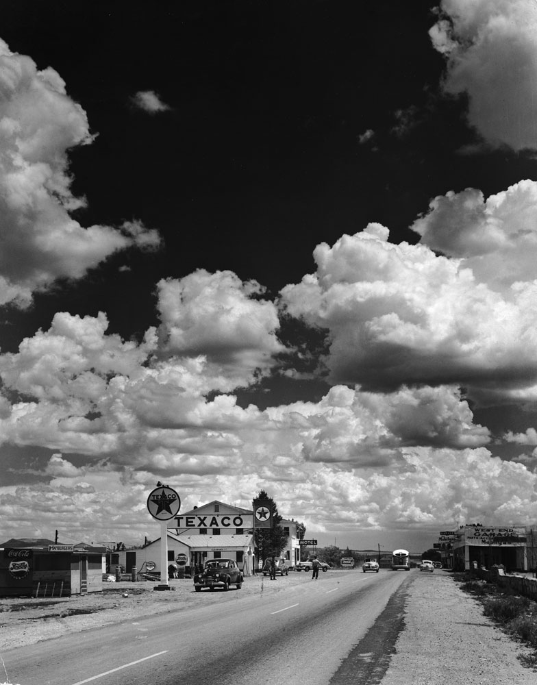 Dramatic cumulus clouds billow above a Texaco gas station along a stretch of Route 66 in Arizona, 1947.