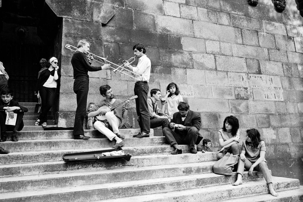 Young Parisians enjoy an impromptu outdoor concert on the banks of the Seine, 1963.