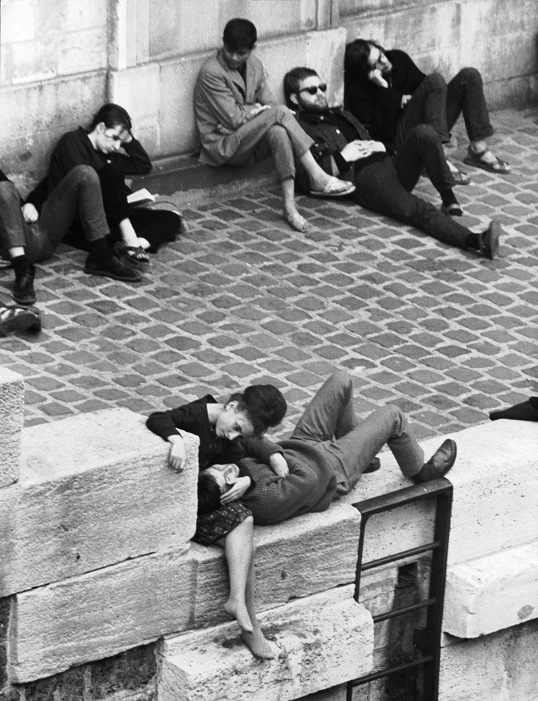 Parisian beatniks hang out on bank of the Seine, 1963.