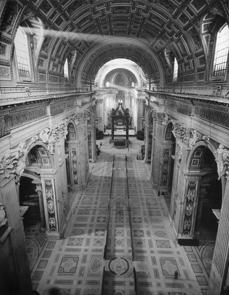 The interior of St. Peter's basilica, with markers indicating the location of the excavation beneath the floor, 1950.
