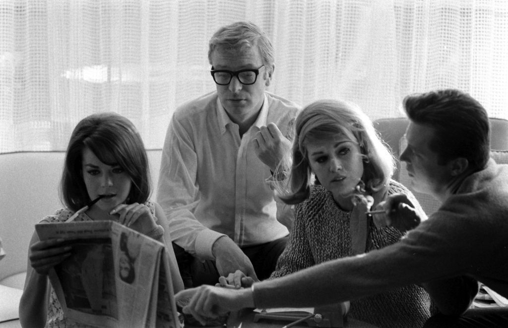 Natalie Wood, Michael Caine and an unidentified man and woman in Los Angeles in 1966.