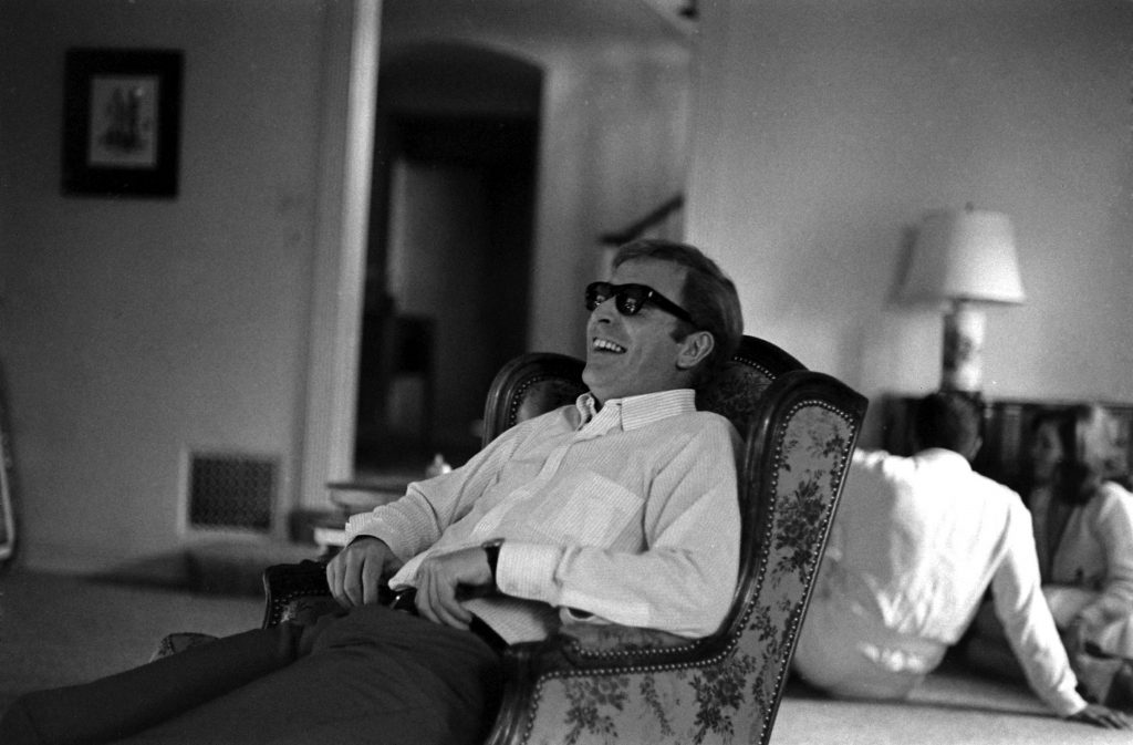 Michael Caine laughing, Los Angeles, 1966.