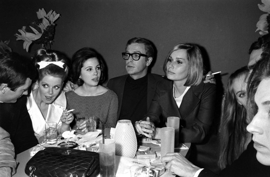 Michael Caine with friends, including the actress Sally Kellerman (on his left), in Los Angeles in 1966.