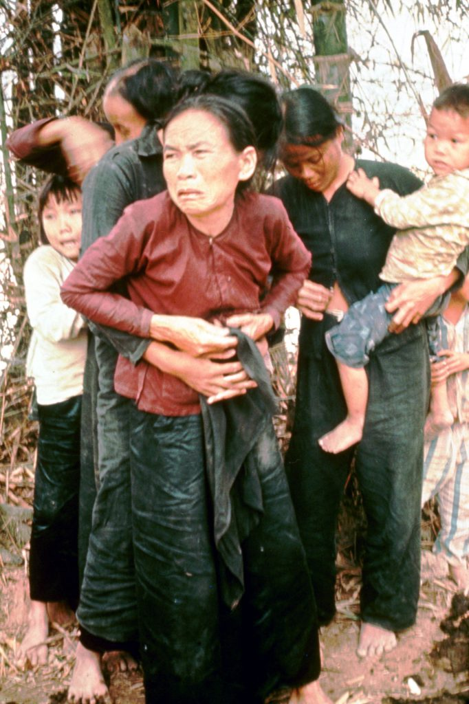 A group of women and children huddle in terror moments before being murdered by American troops in the village of My Lai, Vietnam, March 16, 1968.