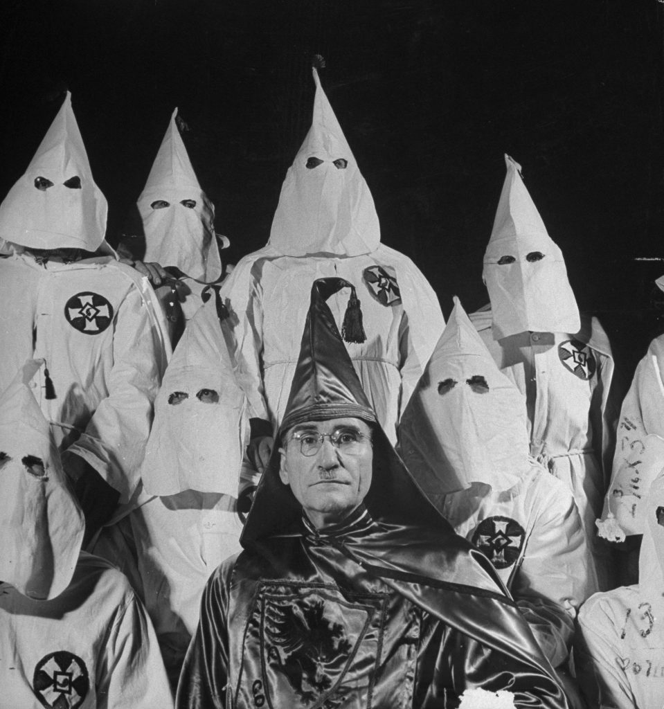 The Grand Dragon of the Fulton County, Ga., Ku Klux Klan, an Atlanta doctor named Samuel Green, surrounded by his assistants, May 1946.