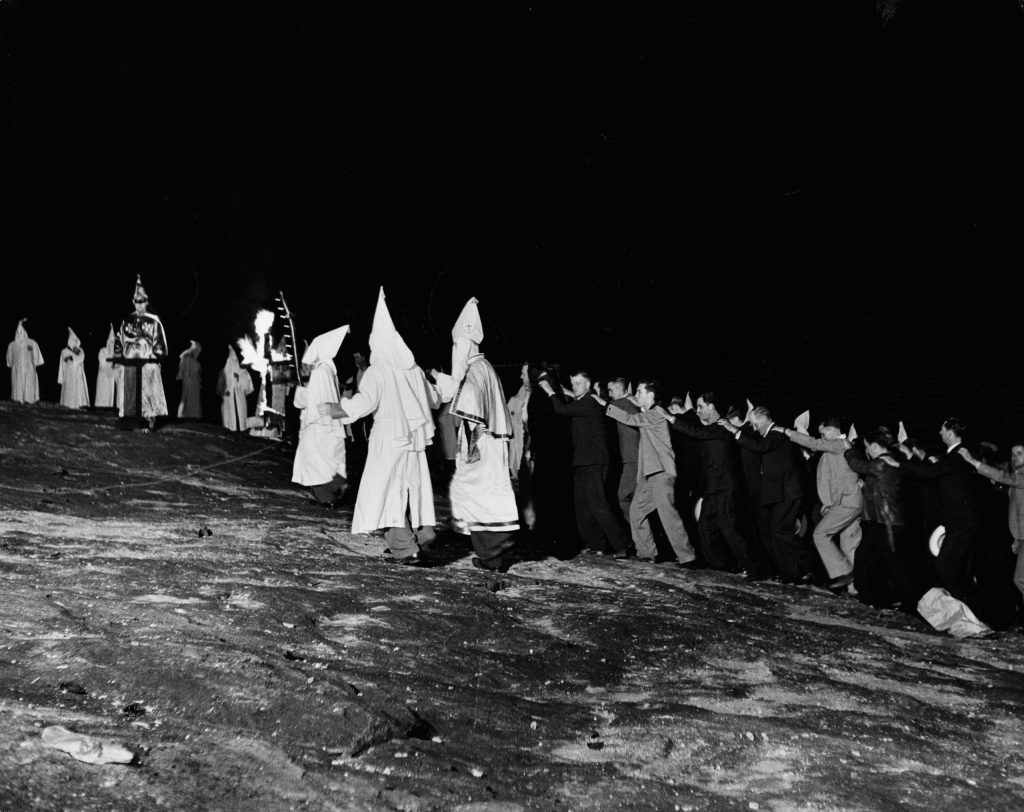 New Klan members march in lock step up to the Klan's big altar on Stone Mountain in Georgia, 1946. The Klan exultingly announced they had initiated 600 new members in one night; observers best guesses were from 150 to 200.