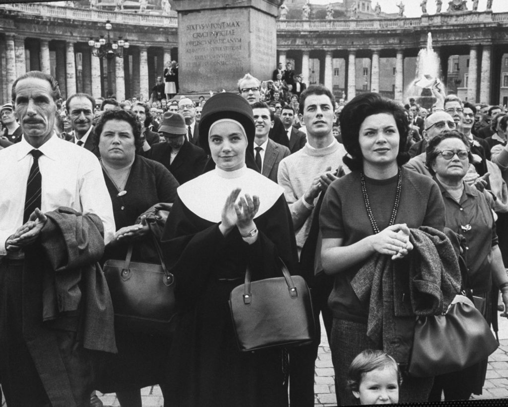 Devout observers of procession of Catholic prelates entering St. Peter's during the Second Vatican Ecumenical Council, 1962.