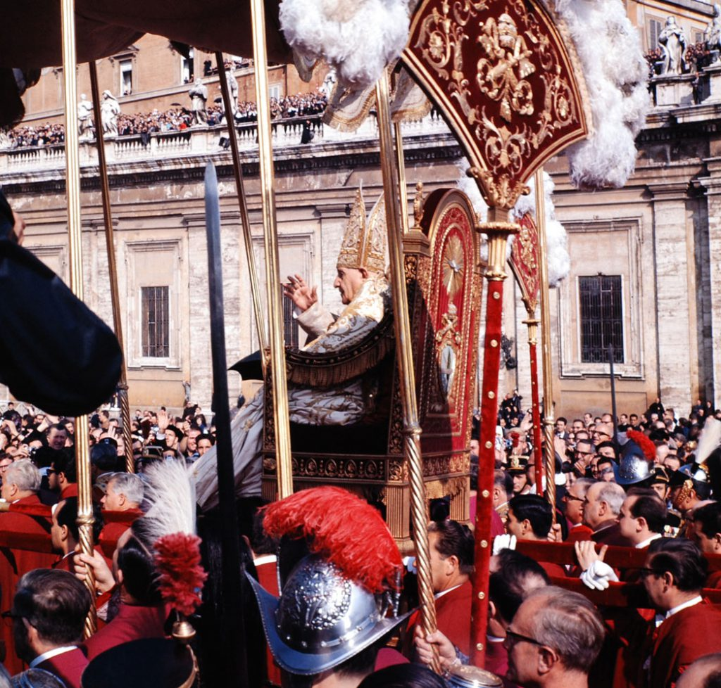 Pope John XXIII rides in procession to St. Peter's Basilica at the Second Vatican Ecumenical Council, 1962.