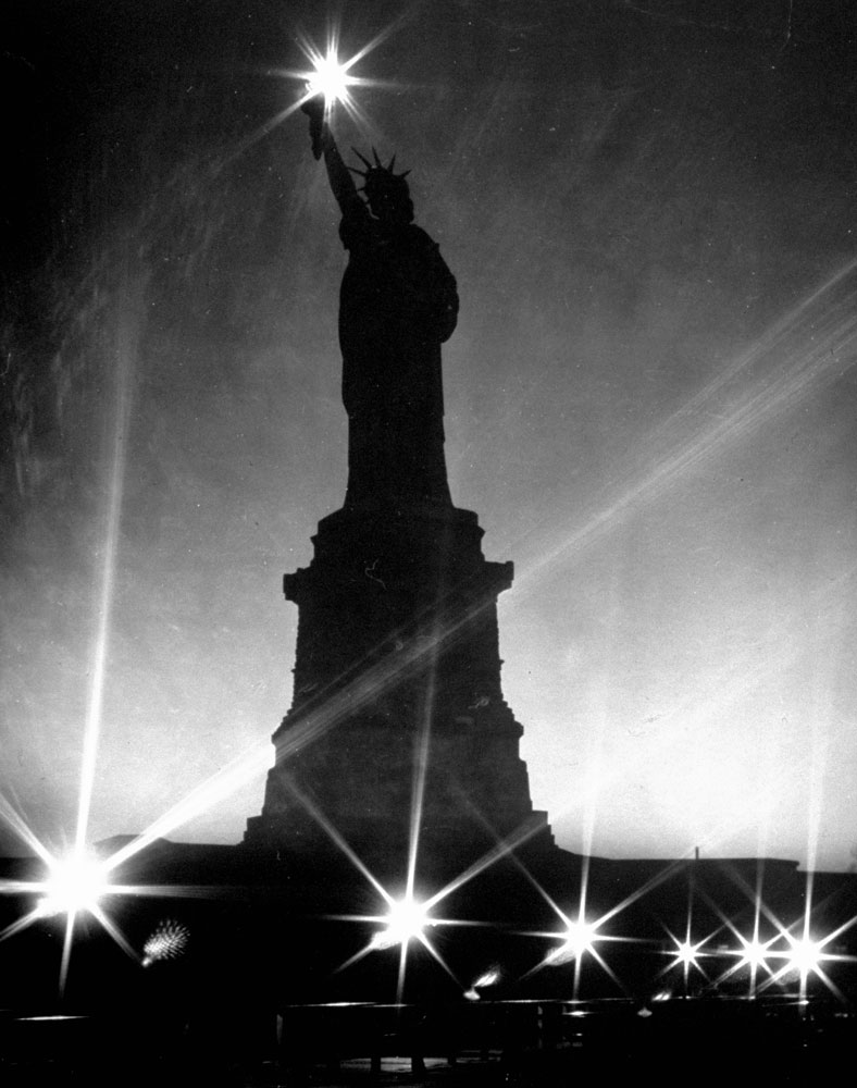 The Statue of Liberty seen during a WWII blackout, 1942.