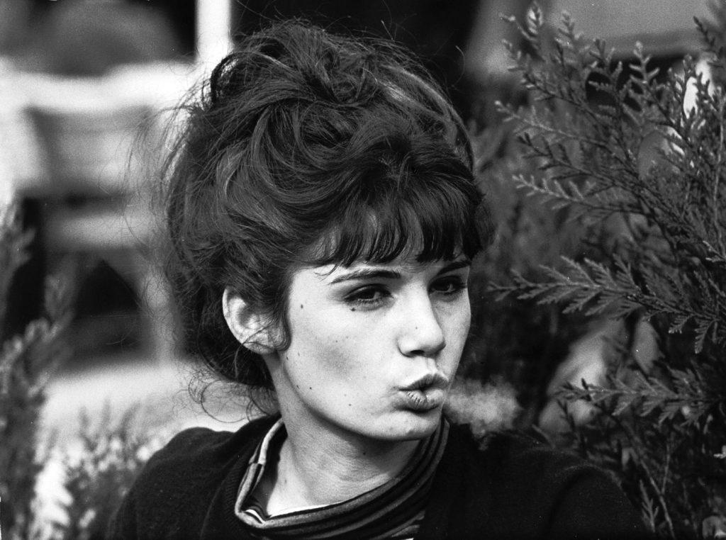 Young Parisian woman exhaling smoke, 1963.