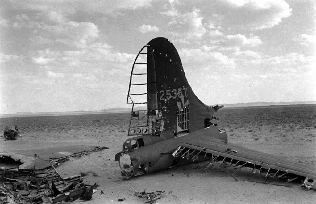 Airplane wreckage in the desert, Tunisia, 1943.