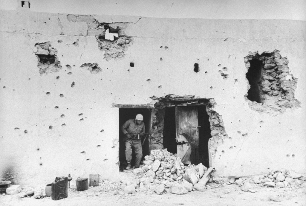 Shelled building behind Italian gun position, Tunisia, 1943.