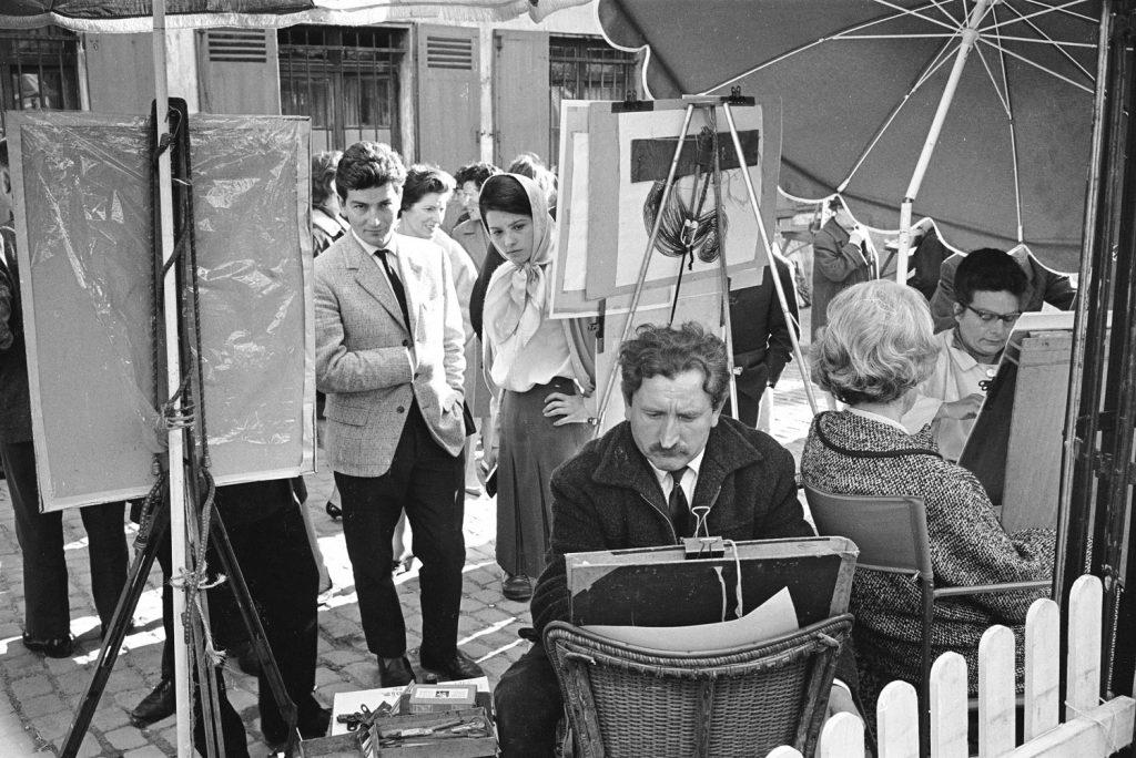 Street artists at work, Paris, 1963.