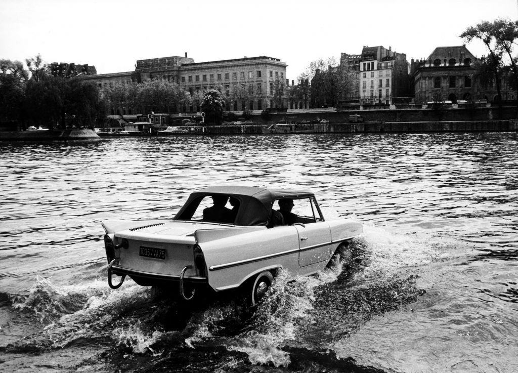 Amphibious car crossing the Seine, 1963.