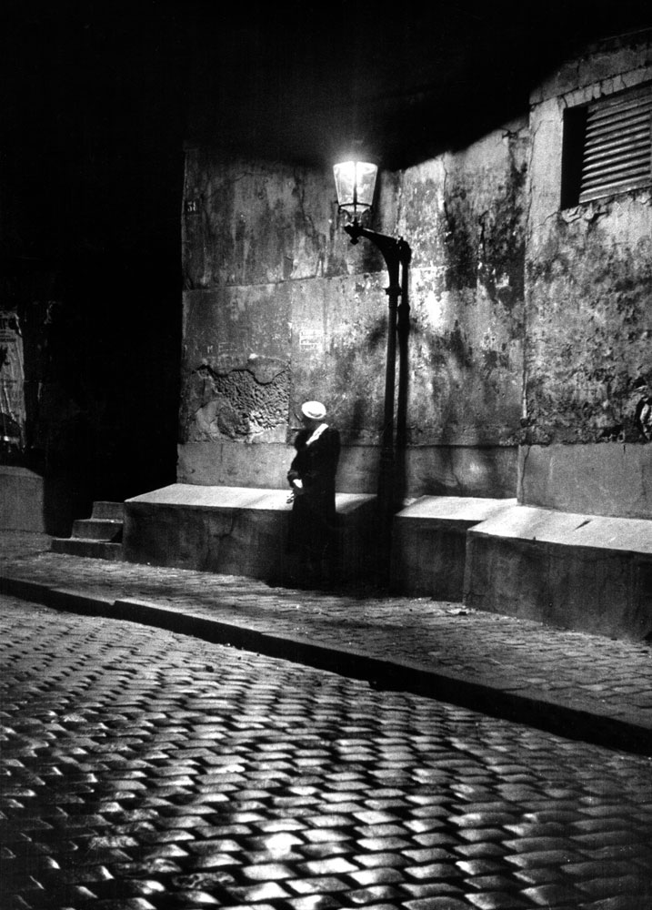 Woman under streetlight in Montmartre at night, 1963.