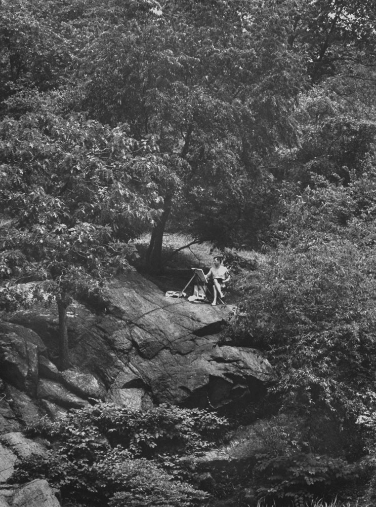 A painter finds a secluded spot, Central Park, 1961.
