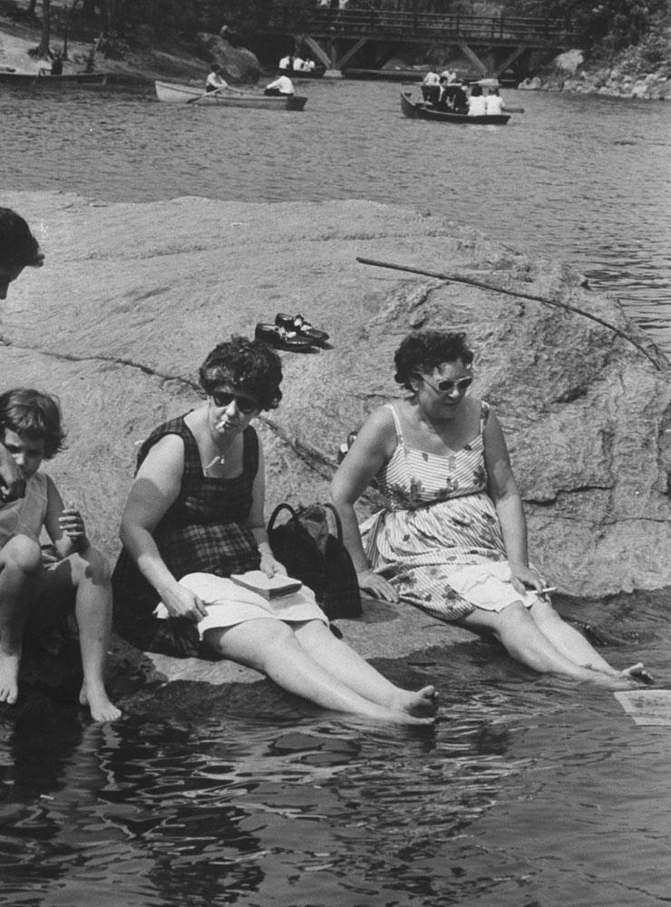 Sunbathers cool their feet, Central Park, 1961.