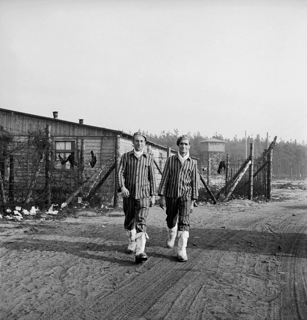 New internees of the freshly liberated Bergen-Belsen concentration camp included this pair of French brothers, Charles and Louis Perret, wearing white boots they took from the Germans, 1945.