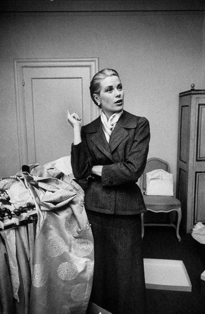 Grace Kelly takes a momentary breather while packing her things before the wedding, 1956.