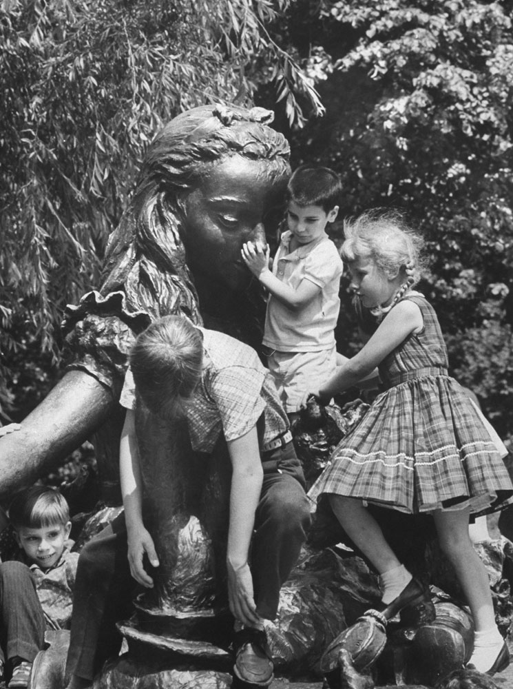 In a wonderland for climbers a bronze Alice is cluttered with children who have scrambled over Mad Hatter and other Lewis Carroll creatures.