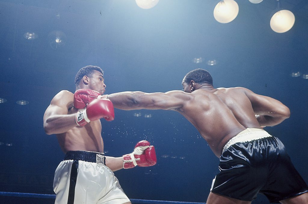 Muhammad Ali dodges a Sonny Liston left jab, Lewiston, Maine, May 25, 1965.