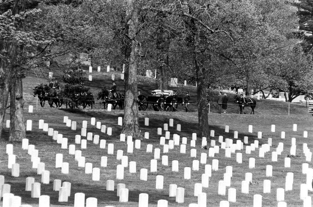 Horses pull a caisson through Arlington National Cemetery, 1965.