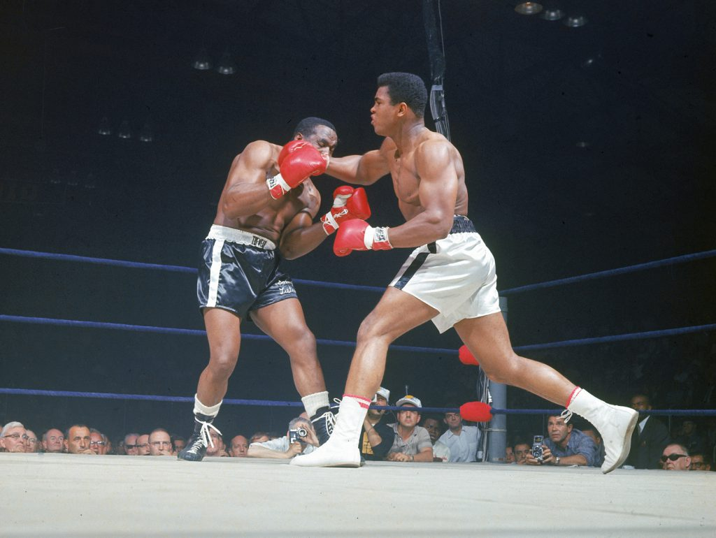 Muhammad Ali rocks Sonny Liston with a right cross, Lewiston, Maine, May 25, 1965.