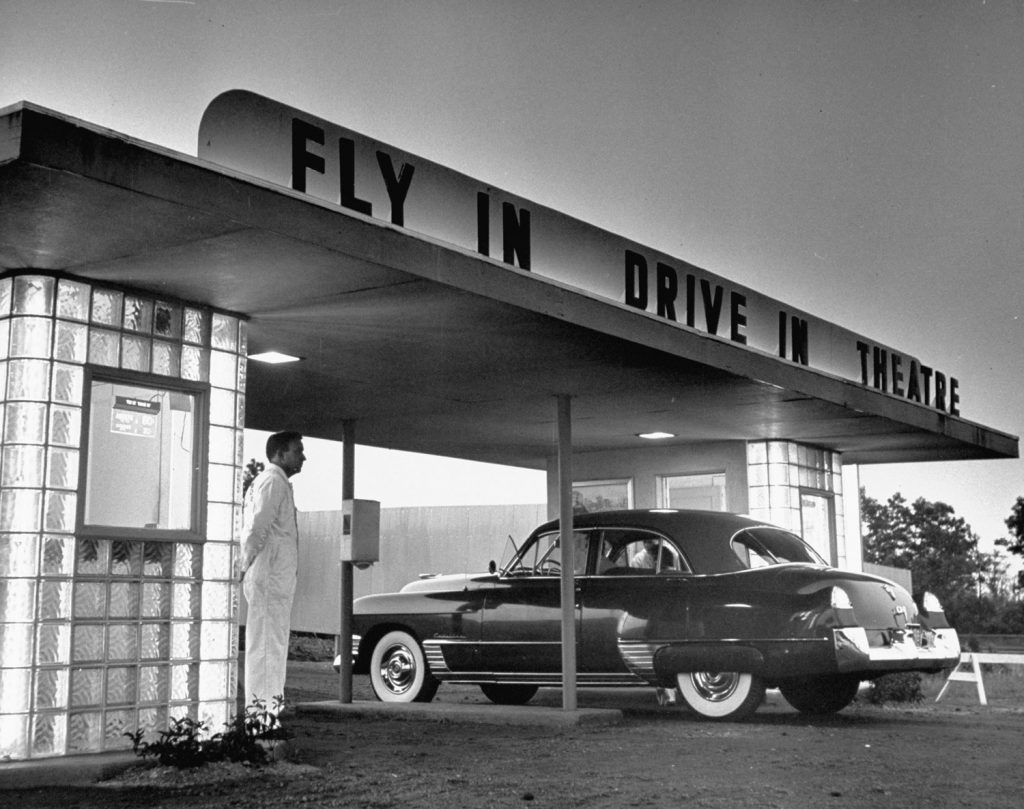 "Customers arriving by car at a ""fly-in drive-in"" theater, New Jersey, 1949."