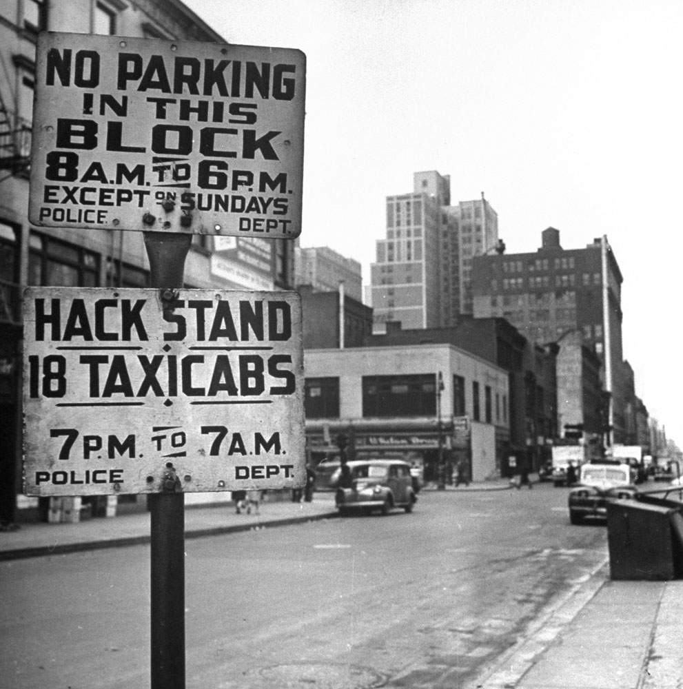 """Taxi """"hack stand,"""" New York City, 1944."""