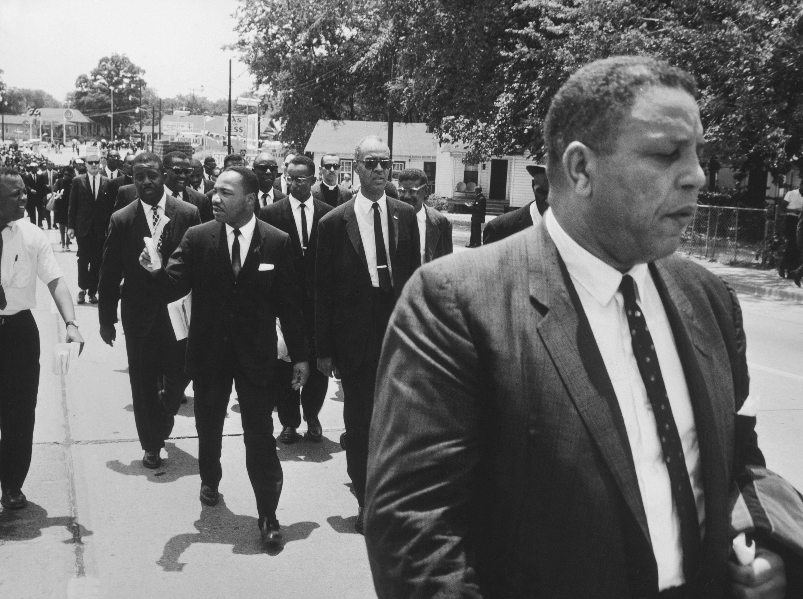 Martin Luther King, Jr., Ralph Abernathy and other civil rights leaders walk in Medgar Evers' funeral procession, Jackson, Miss..