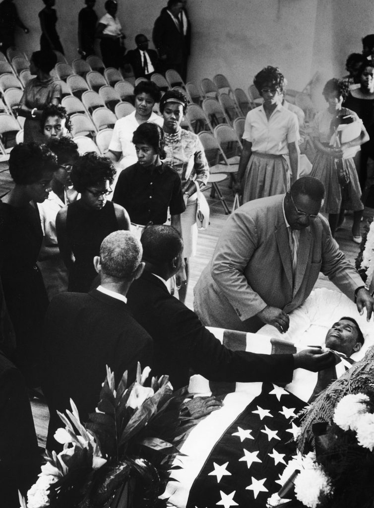 Mourners bid farewell to slain NAACP official Medgar Evers at his funeral.