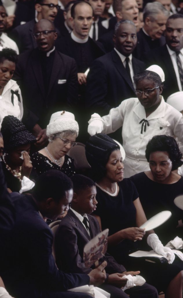 Myrlie Evers (front row, second from right), wife of Medgar Evers; her son, Darrell Kenyatta; and other mourners at Medgar Evers' funeral, Jackson, Miss..
