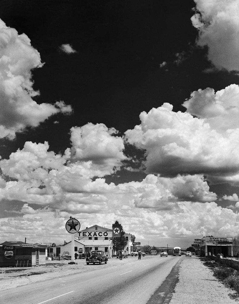 Cumulus clouds billow above a stretch of Route 66 in Arizona, 1947.