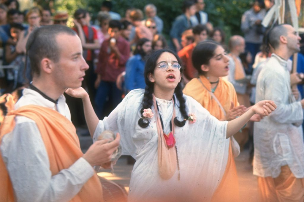 Hare Krishna devotees wear traditional saffron robes and chant in a New York park, summer 1969.
