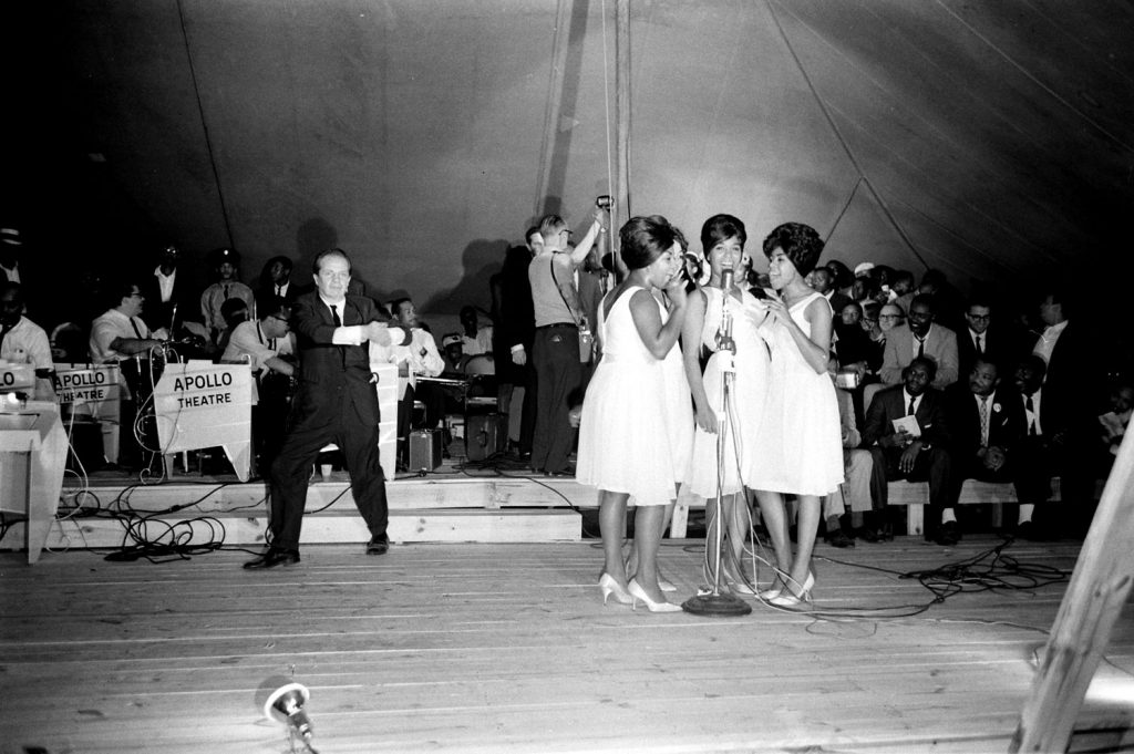 Joey Adams (left), president of the American Guild of Variety Artists, and the Shirelles on stage during the Salute to Freedom benefit concert in Birmingham, Ala., August 5, 1963.
