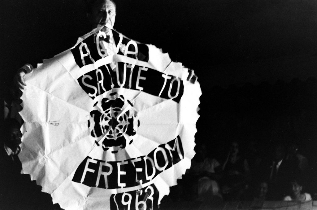 A man holds an American Guild of Variety Artists banner during the Salute to Freedom benefit concert in Birmingham, Ala., August 5, 1963.