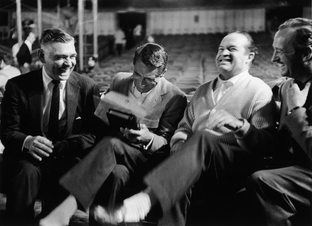 Clark Gable, Cary Grant, Bob Hope and David Niven laugh heartily together during a break from rehearsals for the 30th annual Academy Awards show in Los Angeles, 1958.