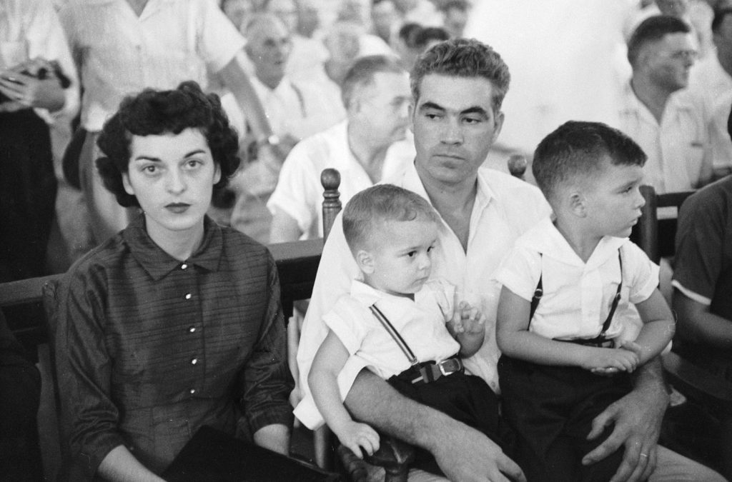 Defendant Roy Bryant sits with his wife Carolyn and their children during his trial for the kidnapping and murder of Emmett Till.
