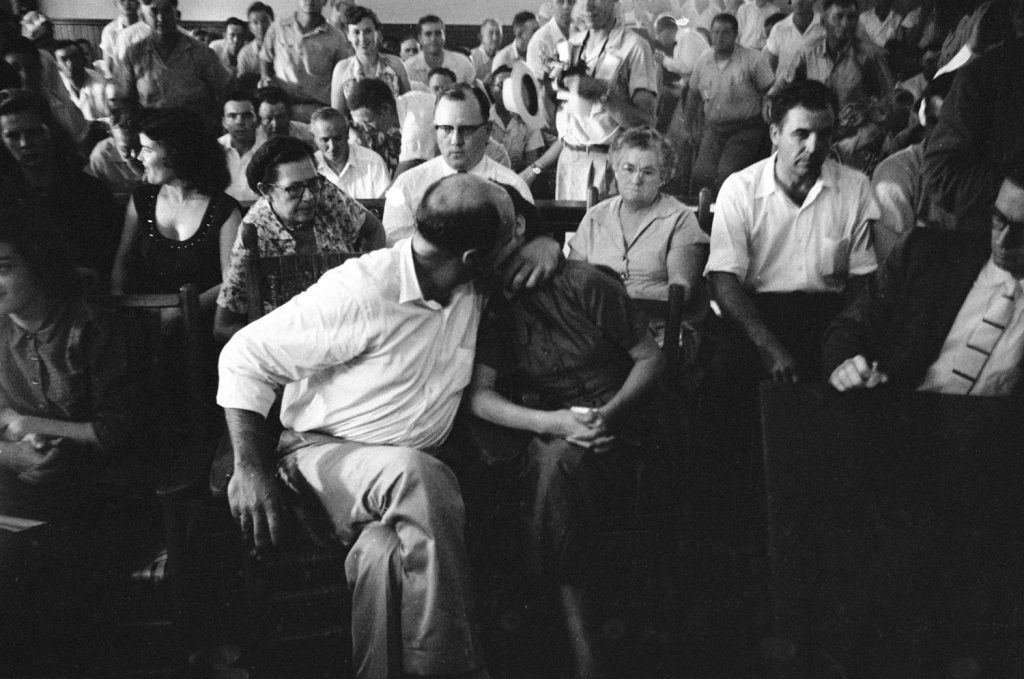 Defendant J.W. Milam kisses his wife Juanita during his trial for the kidnapping and murder of Emmett Till.
