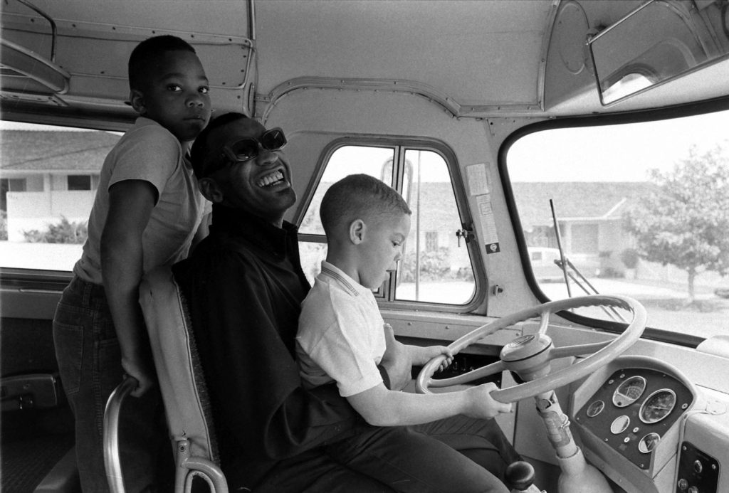 Ray Charles and his sons goof around on his tour bus, 1966.