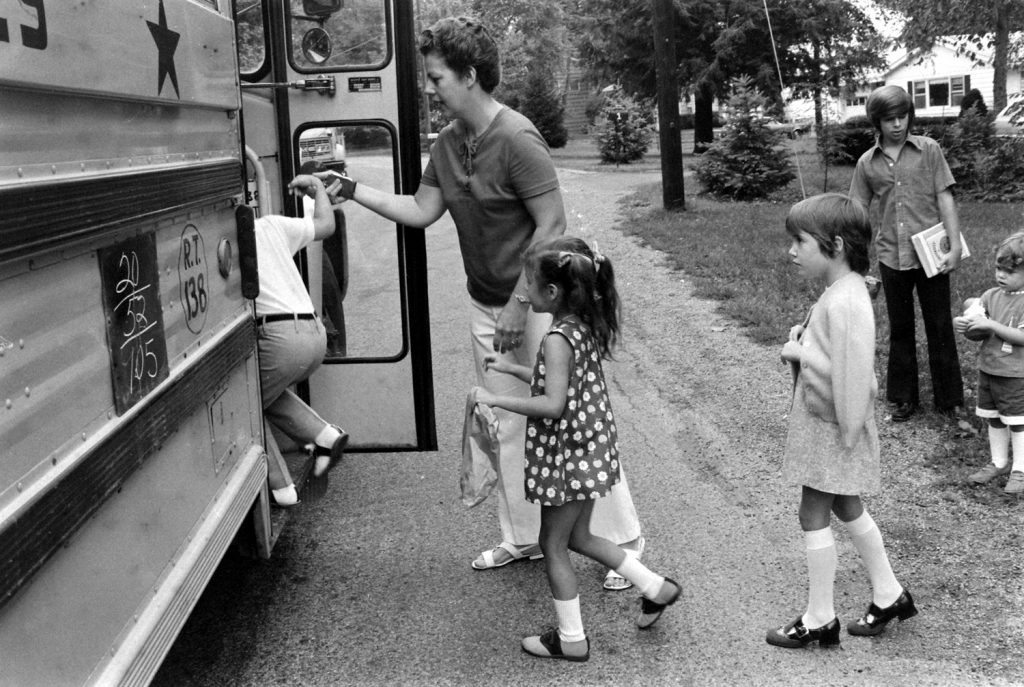 School bus stop, New Jersey, 1971