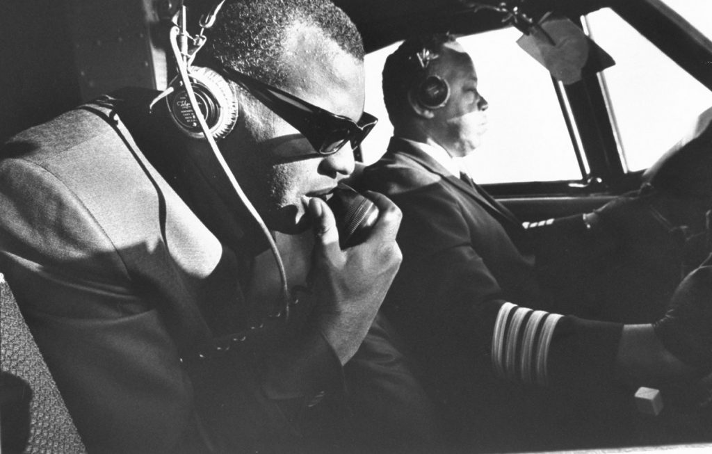 In his 50-seat private plane, Ray talks to a control tower. He likes to sit up in the co-pilot's seat and knows so much about the operation of the plane that, in an emergency, he could take over. 'That would really be flying blind, baby.'