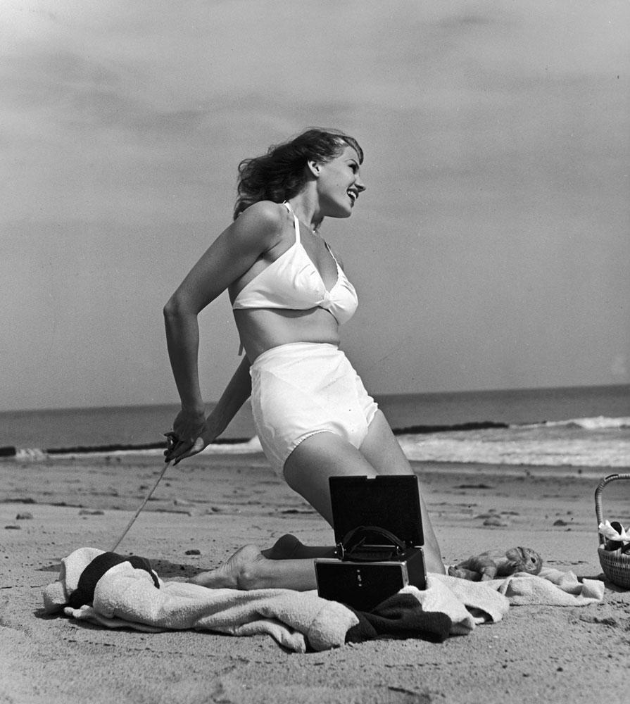 Rita Hayworth on the beach, 1941.
