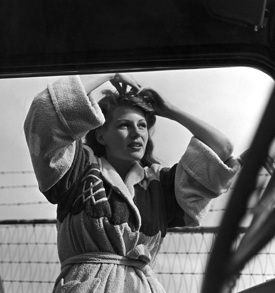 Rita Hayworth, photographed through a car window, 1941.