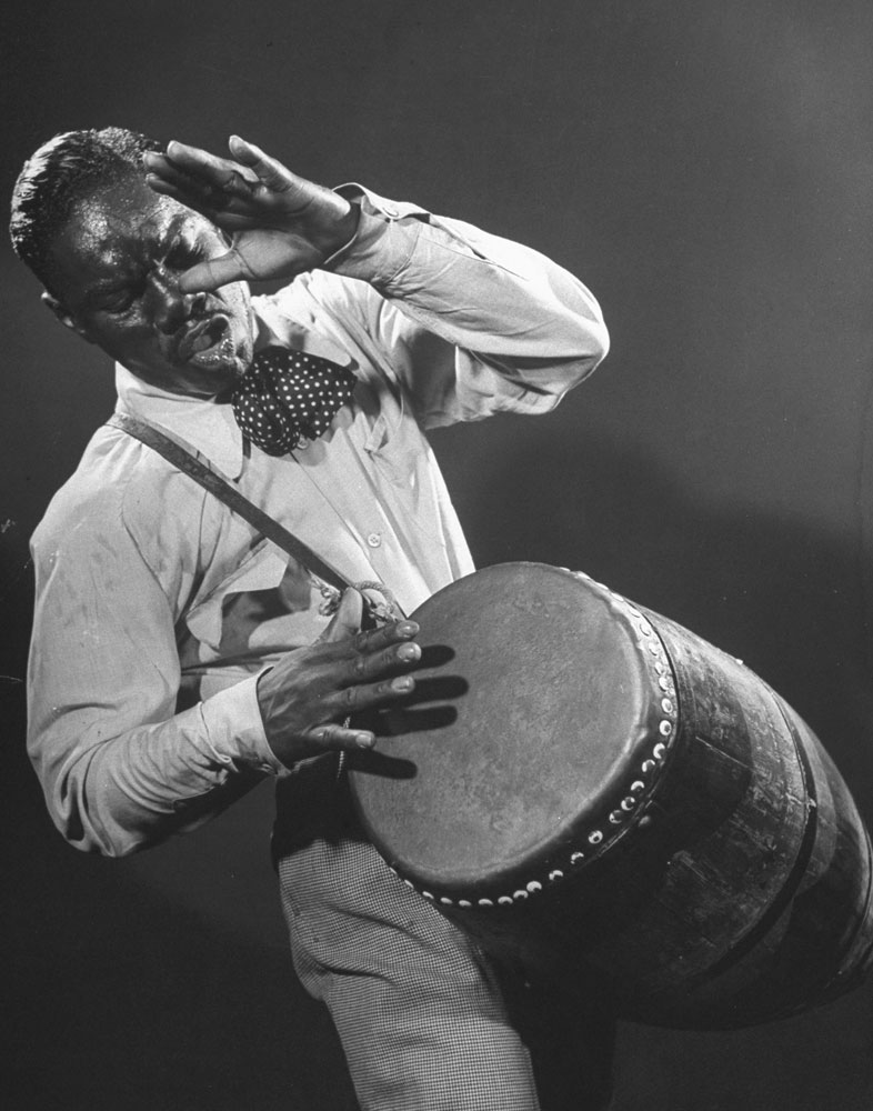 Frenzied Drummer named Gonzales (but called Chano Pozo) whips beboppers into fever with Congo beat. Dizzy rates him world's best drummer.