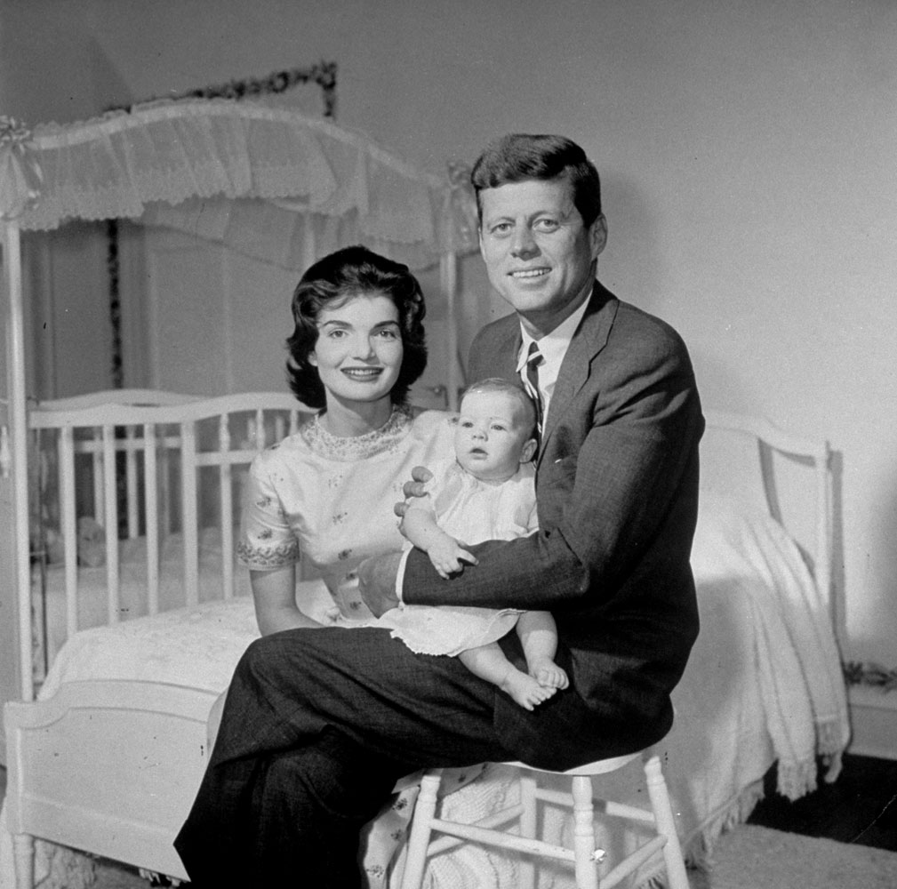 John and Jackie Kennedy with their baby daughter, Caroline, in their Georgetown home, 1958.