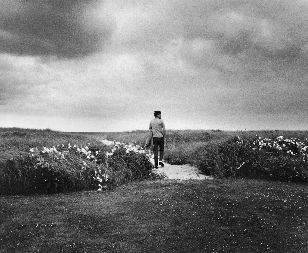 In a picture that he later called his favorite photo of himself, Senator John F. Kennedy walks the dunes near Hyannis Port, Mass., 1959.