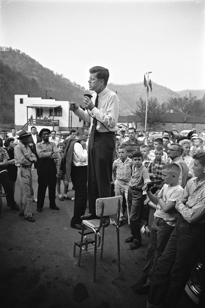 John F. Kennedy gives a speech while standing on a kitchen chair in West Virginia's coal country, 1960.