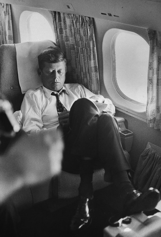 Sen. John F. Kennedy on a private plane during his presidential campaign, 1960.