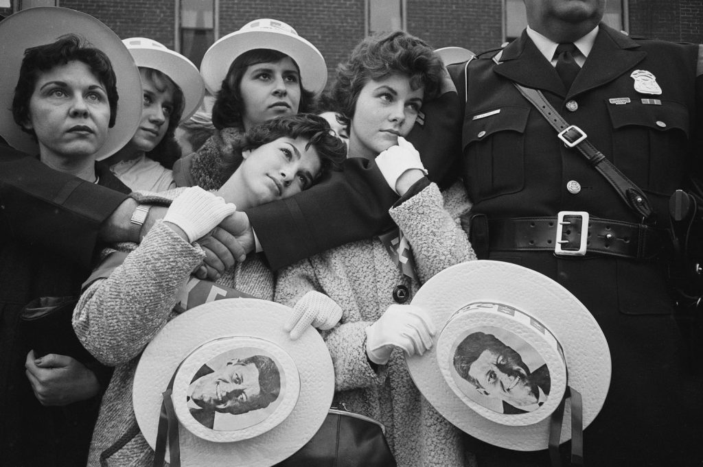 Young female supporters of Sen. John F. Kennedy await his arrival at a campaign appearance in Michigan, 1960.